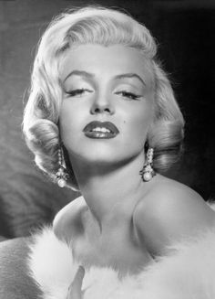 To make her lips appear fuller, Monroe would have her makeup artist apply 5 different shades of lipstick and gloss to create dimension. Darker reds went on the outer corners, while lighter hues were brushed on the middle of the lips.