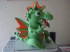 crocheted dragon (appears friendly)