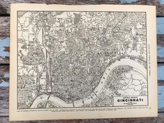 """Antique Map of Cincinnati. City Map. 1937 Historical Print, Lithograph for Framing. 80 Year Old Cincinatti Ohio Street Map to FrameBeautiful Authentic City Map of Cincinnati, OHc 1937Beautiful and interesting antique map! Perfect to frame in your home or office!These city maps definitely have an urban, steampunk, history aficionado feel! The overall measurements of the page are 11 x 14 1/8"""". The actual picture measures 12.25x9"""" Seconds conditions are available of this map for a reduced cost…"""
