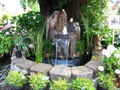 Artificial rock waterfeatures, waterfalls & garden fountains http://garden-trends.tumblr.com/post/44878279929/garden-ponds-fountains-waterfalls-for-your