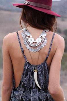 boho, feathers & gypsy spirit - that's actually a really cool and unique spin on wearing necklaces