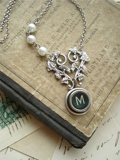 """Vintage like Charm- By PreciousPastimes on Etsy.  She has a lovely shop!!  This nostalgic necklace features a wonderful old Remington letter """"M"""" key in rare dark green with a simple sans-serif font in antique white."""