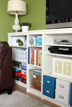 "IHeart Organizing: Built In Beauty: Shows how to create a single cohesive ""built-in"" unit from 5 Ikea shelves, some MDF and some decorative molding. Ikea Billy Bookcase, Built In Bookcase, Bookcase Styling, Ikea Storage, Storage Hacks, Storage Ideas, Console Storage, Office Storage, Ideas"