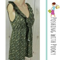 """NWT Max Azria Moss Green Blouse Tank This is one very classy tie back summer top. The ruffle adds a touch of style to take this top from jeans to dress pants. So beautiful!   Chest 17"""" across Elastic band under chest 13.5"""" relaxed, stretches about 2"""" comfortably.  Bottom hem 21"""" across.  Length 26"""".   55% cotton and 45% modal.   Store code: RT2 Max Azria Tops Blouses"""