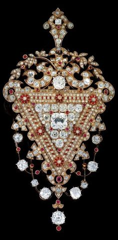 A diamond brooch, total weight c. 14.20 ct Rosé gold 580, silver 800, old-cut diamond c. 2.20 ct, smaller old-cut diamonds, diamond rhombs total weight c. 12 ct, some enamelling, rubies, signed Vienna Biedermann 1879, 47.6 g, with case