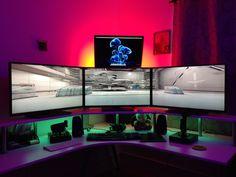 tri-monitor setup with lights