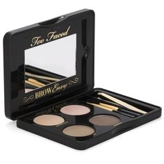 Too Faced Brow Envy Kit. It's filled with all the essentials needed to shape, define, fill, and set brows. Includes tweezers, three stencils, angled brush and brow comb. With this kit you can customize color with two shades of brow powder and hold brows in place with the conditioning wax.