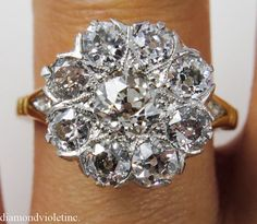 This breathtakingly beautiful CIRCA 1890s Authentic Victorian Old European Diamond Flower shaped Platinum Top and 18k Yellow Gold Cluster Ring