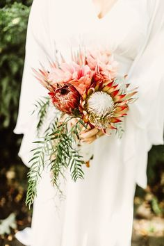 Modern wedding bouquet idea - Protea bouquet for bride with greenery {Fresh Designs Florist}