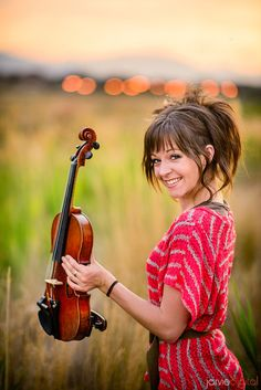 Lindsey Stirling..... OMG she is like so amazingly talented. Dancing while playing violin.......