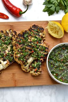 BBQ Cauliflower Steak with Chimichurri A healthy and low carb dish for vegans and meat eaters alike! Barbecued cauliflower steaks topped with chimichurri sauce(Paleo, Gluten Free, Vegan, - BBQ Cauliflower Steak with Chimichurri Bbq Cauliflower, Cauliflower Recipes, Vegetable Recipes, Grilled Cauliflower Steaks, Vegetable Ideas, Grilled Pizza, Grilled Zucchini, Whole Food Recipes, Cooking Recipes