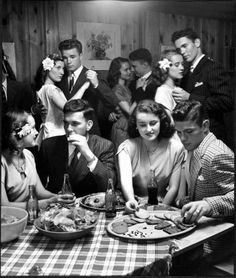 Teenagers sitting in a booth and socializing. US, 1944;  by Nina Leen.