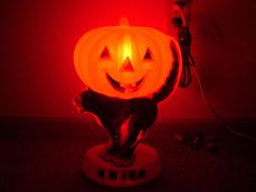 Vintage Empire plastics Blow Mold Halloween Pumpkin Man with the Black Cat in the lower portion Light comprised of hard plastic and measuring 14 inches high by about 7 inches across. Item is in great