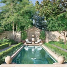Inspired by classical gardens of France and Italy, the landscaping by Burks Hamner marries classic architecture with potted olive trees and formal hedges. Outdoor Rooms, Outdoor Gardens, Outdoor Living, Formal Gardens, Enchanted Home, Dream Pools, Swimming Pool Designs, Pool Landscaping, Backyard Pools