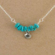 A sterling silver shell charms is the focal for this ocean-themed necklace. The turquoise chip beads that surround the fan-shaped shell evoke images of calm turquoise waters. The necklace is 16 inches including the sterling silver rolo chain, the focal and the sterling oval lobster clasp which is accented by a little turquoise bead. If youd like your Shelly necklace to be a different length let us know. Find more fine artisan-crafted jewelry here…