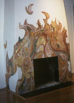 What a beautiful idea for a mosaic around a very simple fireplace!