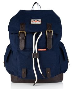 Superdry Rookie Scoutpack- I see a taller and more faded version of this pack without the top buckles- or maybe they are torn off or hanging off from so many suit runs- top is cinched by drawstring.  no white lace or labels for Suit Run