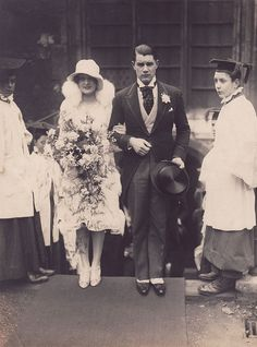 Beautiful 1920s wedding. The groom looks like he's trying so hard to be so serious!