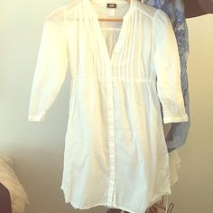 White dress with buttons down front Great as a summer dress or cover up! H&M Dresses Long Sleeve