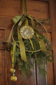 Christmas tree branch with a large horn and ribbon makes the perfect wreath.
