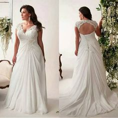 This plus size bridal gown has an opne back.  The v neck line shows the bust area well. Get pricing on #plussizeweddingdresses that can be custom made to your preferences on our website.  There is where you will find information regarding inexpensive #replica dresses too.  We can make a close replica of a dress that may be out of your price range but for less than the original - especially if it was a couture design.  Just email us for pricing.