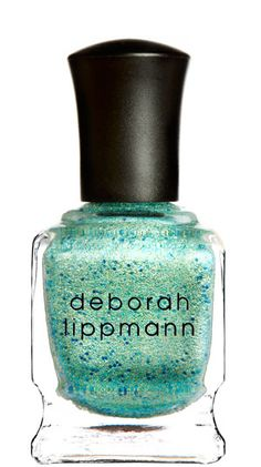 This bright aqua polish comes with flecks of blues and greens that are to die for. - via StyleList