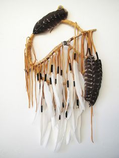 cool idea for a dreamcatcher, using a twig branch as the base