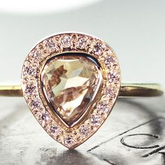 1.43 carat champagne diamond ring with a diamond halo in yellow gold chincharmaloney.com