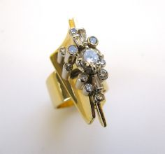 Wachler A Diamond Gold Modernist Ring  | From a unique collection of vintage engagement rings at http://www.1stdibs.com/jewelry/rings/engagement-rings/