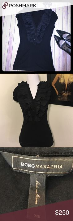 """🆕 BCBG Ruffle Front Shirt Gently Used BCBG cap sleevewith a slight puff sleeve, ruffle front shirt. Shirt is cotton and ruffles are woven with button detail half way down the front. Approx. measurements bust 30"""", waist 26"""", length from shoulder to hem 25"""" BCBGMaxAzria Tops"""