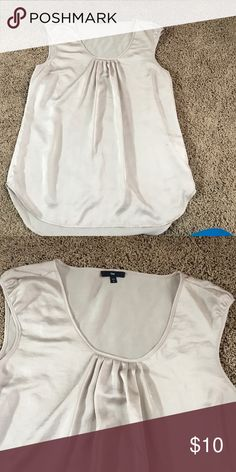 Gal cap sleeved top Champagne colored cap sleeved top. Loose fitting and could go with anything! Tuck it in to your favorite skirt or wear loose over your best pair of skinnies. 100% polyester GAP Tops Blouses