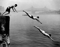 East River Divers. New York City, near the 59th Street Bridge. 1948.  Photograph by Arthur Leipzig  © Arthur Leipzig