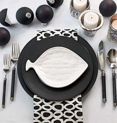 A black and white table setting with a fish plate.