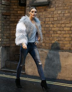 s having a wonderful weekend so far! Here I am during my first full day of shows in London for LFW. I'm wearing a pair of distressed Black Orchid jeans, Tabitha Simmons booties and a Skin and Thread sweater. I topped it off with a shearling bomber jacket from Charlotte Simone and a bracelet from Verdura. 160220-LFW_P8X8007