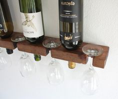 Store your wine bottles with style in this charming wall mounted Wine Rack that Holds 3 Bottles & 4 Wine Glasses. Designed for smaller spaces this piece creates a nice eye-catching display while keeping your wine bottles within easy reach. Makes an ideal gift for the wine lover on your list.  - Made of Western cedar - Stained a warm Golden Oak color - Finished with a clear satin - Dimensions: 22 W x 2H x 4D - Mounting screws & installation instructions are included for mounting both into a…