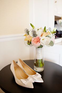The brides bouquet looks incredible next to her beautiful shoes at this classic Cape Cod wedding.