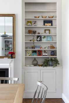 Farrow & Ball Ammonite grey walls, bespoke cabinetry, reclaimed parquet & vintage mirror in the open plan dining room of this Edwardian house in South London. Interior Design by www.imperfectinteriors.co.uk Photos by Chris Snook Built In Cupboards Living Room, Dining Room Shelves, Open Plan Kitchen Living Room, Living Room Storage, Living Room Sofa, Living Room Decor, Dining Room Colour Schemes, Dining Room Colors, London Living Room