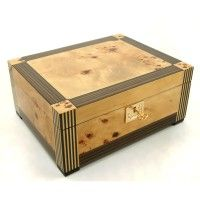 TRADITIONS 80 CIGAR STAR HUMIDOR This cigar humidor is for someone who appreciates fine woodworking, made using Zebrawood, Mapa Burl, and unmatchable hand crafted inlays. Our team shows off there skills when making this humidor. http://cigarstar.ca