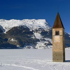 Lago di Resia (Lake Reschen) in winter, South Tyrol, Italy.
