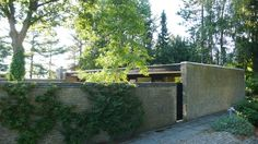 From the outside. Brick Wall fence integrated in the house design