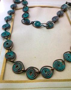 handwrapped copper spiral chain w/ green patina.  Venice Beach Adornments