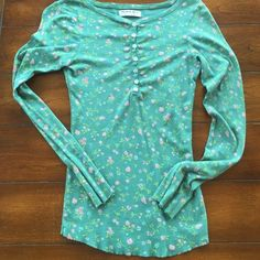 """MICHAEL STARS henley. Green. One size This is a Michael Stars henley in a pretty green with a cute floral pattern with pale pink and yellow. It is a """"one size fits most"""" but it is small. I would say it is an XS, S or M. It has plenty of stretch & conforms to your body. So cute with jeans. Great everyday piece for school or a casual day. Michael Stars Tops Tees - Long Sleeve"""