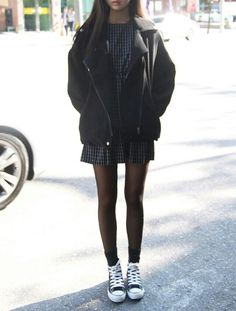 Hightop converse, socks, tights, dress, oversized jacket. All black and white.