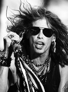 Steven Tyler...Aerosmith My mom didn't know Steven Tyler had a band...more or less a professional musican...she grew up in the 80s! WTF!?! Even my DAD knew who he was & he's musically impared!