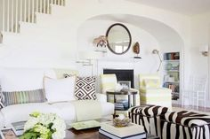 Love the mirror over the fireplace. (design by Kate Jackson from the Coco Cozy Blog)