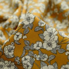 wide, cotton poplin print fabric with a beautiful ivory floral print on a mustard background. This fabric would make a stunning dress, top or skirt. Floral Tie, Floral Design, 1950s Fashion Dresses, Fabric Board, Vintage Dress Patterns, Fabric Suppliers, Fabric Online, Poplin, Printing On Fabric