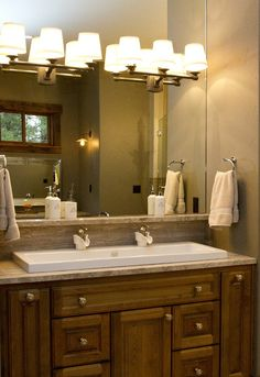 Double trough sink with lights on mirror.                                                                                                                                                                                 More
