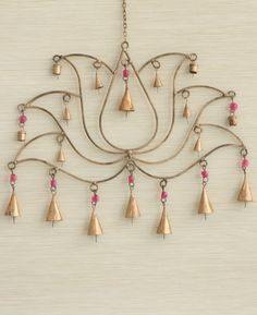 Wall Art from India! A lotus chime made with traditional bells is a wonderful way to add music to your life. Handmade by artisans in India and bedecked with bright pink beads for a splash of color. Indian Home Decor, Diy Home Decor, Indian Inspired Decor, Indian Decoration, Suncatchers, Mobiles, Deco Boheme Chic, Buddha Wall Art, Pooja Room Design