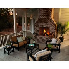 Brick fireplace on covered porch. The fireplace makes the whole porch that much better.