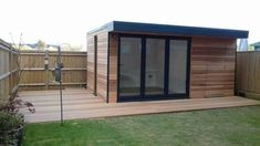 The decking and cladding finish for this garden studio make it blend seamlessly into one, with a sleek and stylish design. Shed Office, Garden Office, Garden Studio, Cladding, Bespoke, Tiny House, Backyard, Layout, House Design